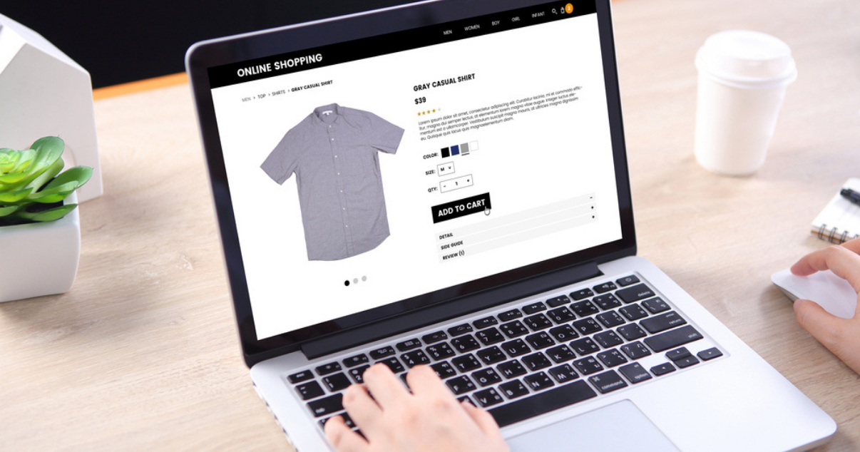 Man using his computer while making a purchase online from an ecommerce store