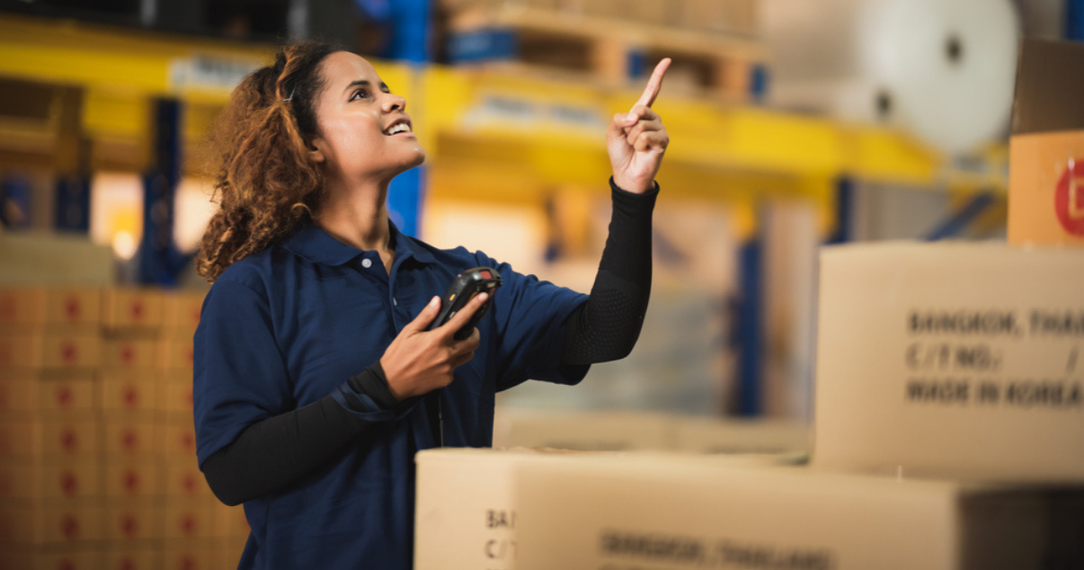 Woman working at a warehouse full of boxes from ecommerce purchases