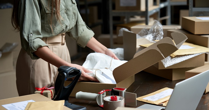 Woman preparing to ship her e-commerce products